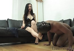 Domiant woman treats her male slave with reproachful fetish