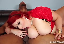 A black man fucks Eliza Allure on her couch