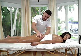 Vienna Black receives a fortifying oil massage before fucking her masseur