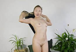 Amateur slut Lira Kissy loves undressing with an increment of flashing with her pussy